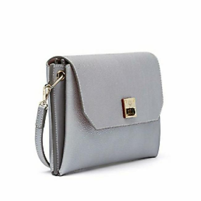 MCM Clutch Milla Nwt's Convertible with Removable Strap Spike Silver Leather Cross Body Bag MCM Clutch Milla Nwt's Convertible with Removable Strap Spike Silver Leather Cross Body Bag Image 1