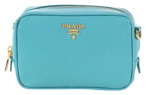 3f1bf0ceb367f7 Added to Shopping Bag. Prada Pr.l0803.03 Turquoise Gold Hardware Small  Cross Body Bag. Prada Camera Mini Saffiano Blue Leather ...