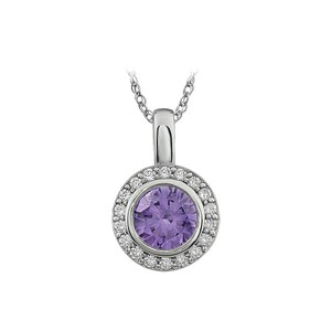 Marco B Purple Cubic Zirconia Sterling surrounded by white Cubic Zirconia .