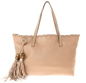 946afa6a880 Gucci Leather Tote in Brown - item med img. Gucci. Bamboo Tassel Shopper ...