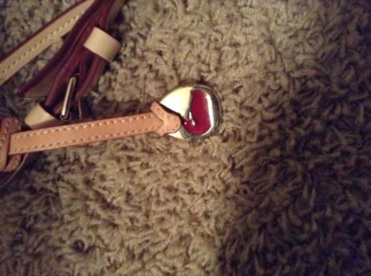 Dooney & Bourke Blue And Red With Tan Clutch