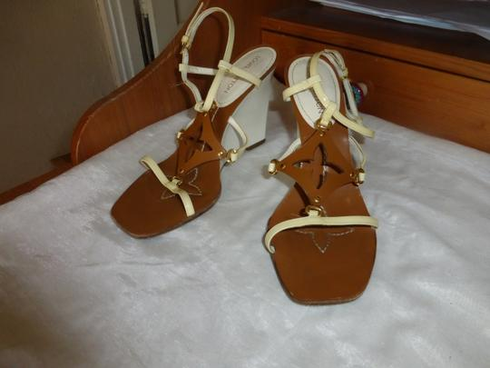 Preload https://img-static.tradesy.com/item/22051937/louis-vuitton-white-and-brown-italy-wedges-size-eu-365-approx-us-65-regular-m-b-0-0-540-540.jpg