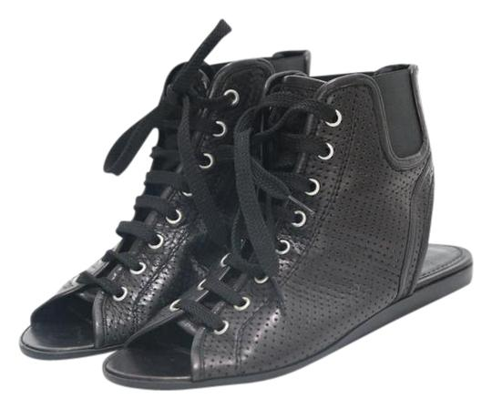 Preload https://img-static.tradesy.com/item/22052196/givenchy-black-perforated-leather-lace-up-sandals-flats-size-eu-365-approx-us-65-regular-m-b-0-1-540-540.jpg