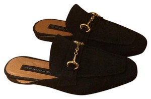 Steven by Steve Madden black suede with gold buckle. Mules