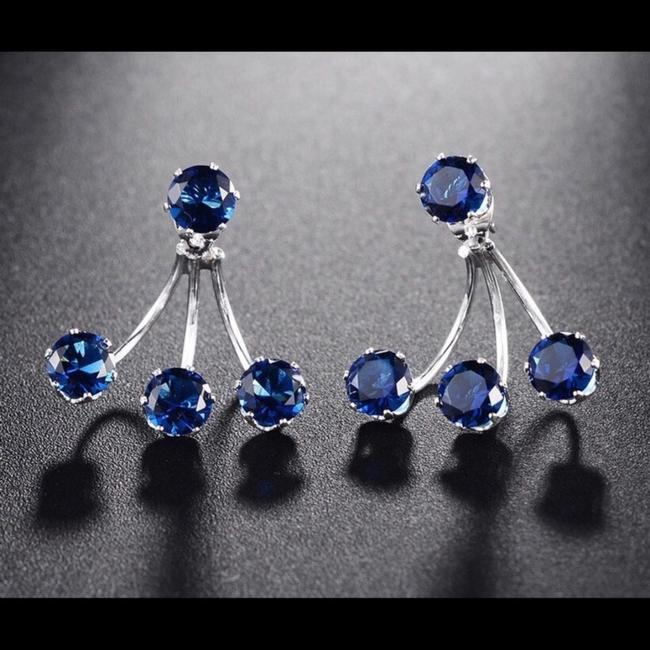 Item - Silver/ Blue Stone Sapphire Crystal Claws Earrings