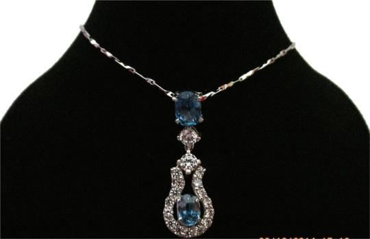 Preload https://img-static.tradesy.com/item/2206017/white-18k-over-sterling-silver-blue-stones-and-cz-pendant-charm-0-0-540-540.jpg