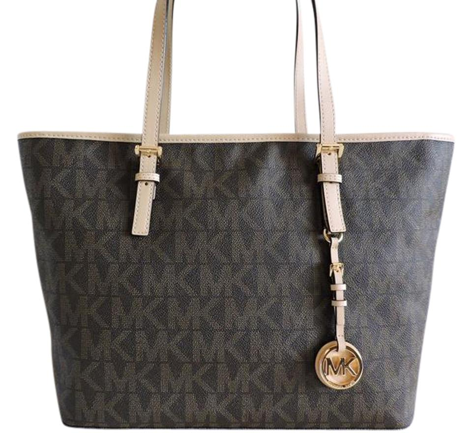 6558b2d9e8fc Michael Kors Jet Set Travel Signature Zip Brown Coated Canvas   Leather Tote