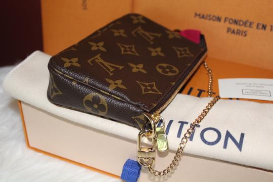 Louis Vuitton Holiday Pochette Neverfull Wristlet in Brown