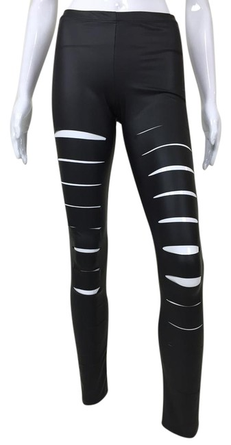Preload https://img-static.tradesy.com/item/22080257/black-slashed-across-leggings-size-8-m-29-30-0-1-650-650.jpg