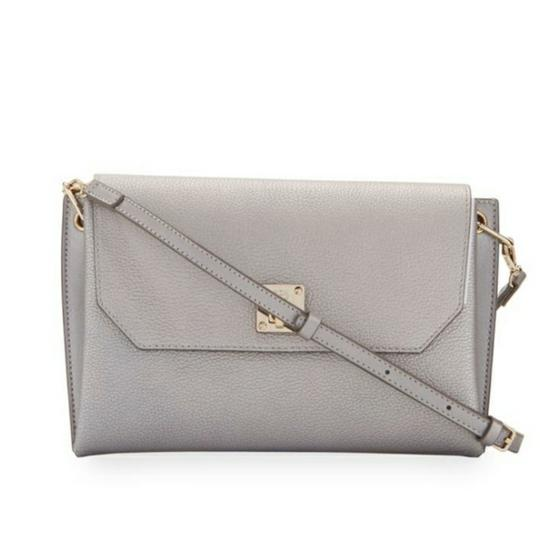 Preload https://img-static.tradesy.com/item/22081151/mcm-nwt-s-milla-convertible-clutch-with-removable-strap-spike-silver-leather-cross-body-bag-0-2-540-540.jpg