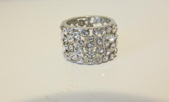 Preload https://img-static.tradesy.com/item/22083164/real-collectibles-by-adrienne-silvertone-crystal-wedding-band-9-ring-0-1-540-540.jpg