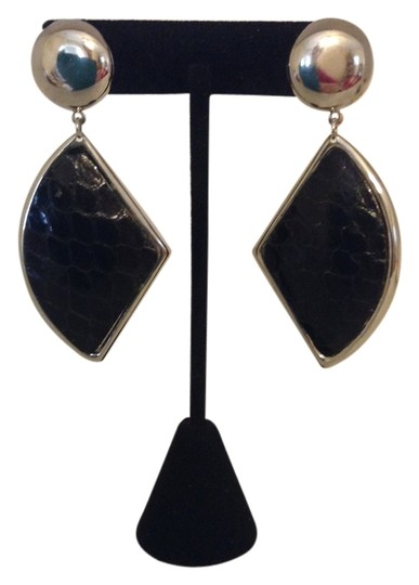 Preload https://item4.tradesy.com/images/black-and-silver-dangled-pierced-earrings-2208593-0-0.jpg?width=440&height=440