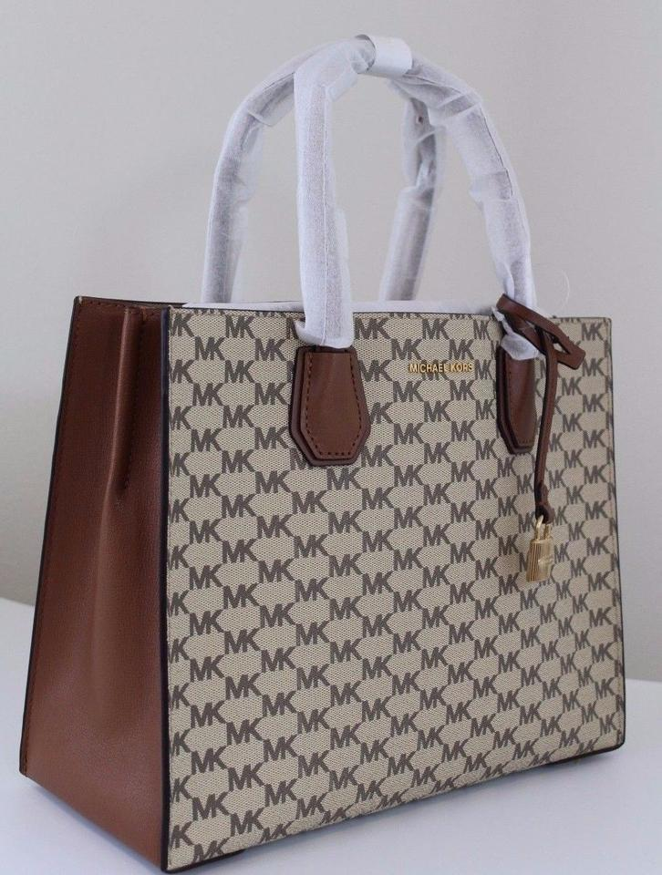 4a3c3401e745 Michael Kors Studio Mercer Large Convertible / Cherry Tote in  Natural/Luggage Image 11. 123456789101112