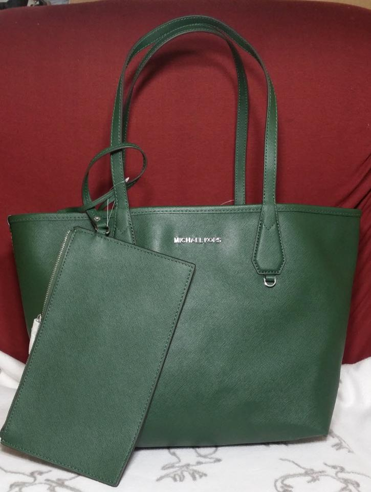 9084f71ac282 Michael Kors Candy Reversible Includes Pouch Red Tote in moss navy Image 9.  12345678910
