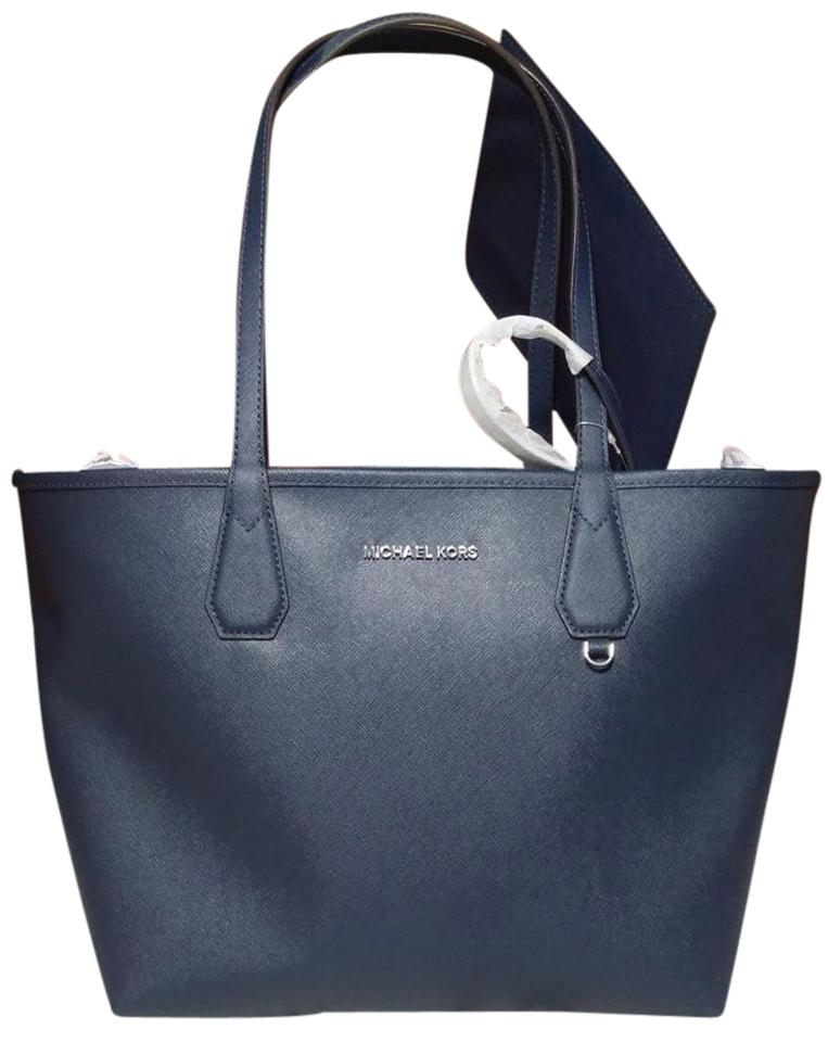5d1357f0bffd Michael Kors Candy Reversible Includes Pouch Red Tote in navy steel blue  Image 0 ...