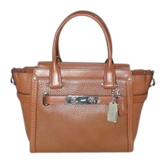 Preload https://img-static.tradesy.com/item/22093216/coach-swagger-saddle-37444-21-carryall-in-saddle-pebbled-leather-satchel-0-1-540-540.jpg