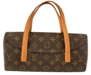 Louis Vuitton Monogram Sonatine Wristlet in Brown