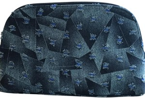 Bergdorf Goodman blue jean with patch work variations Clutch