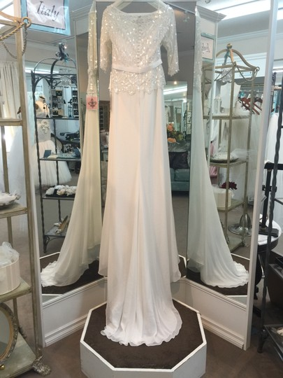 Preload https://img-static.tradesy.com/item/2210151/pronovias-off-white-chiffon-laima-traditional-wedding-dress-size-8-m-0-1-540-540.jpg