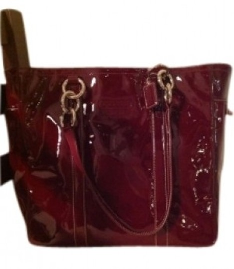 Preload https://item5.tradesy.com/images/coach-with-silver-h-burgundy-patent-leather-shoulder-bag-22104-0-0.jpg?width=440&height=440