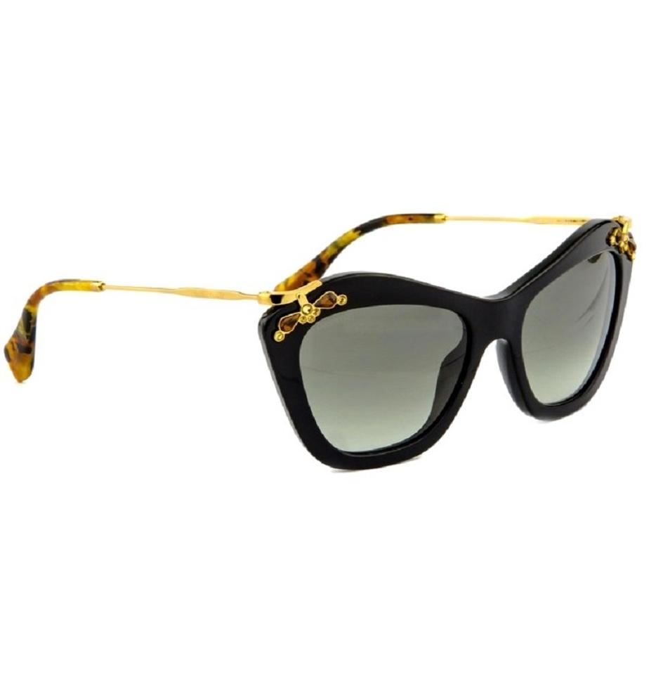 6d265992b6 Miu Miu Black   Gold Cat Eye Glow Sunglasses Tradesy