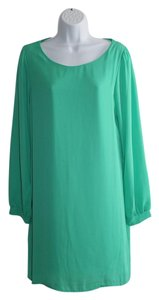 Coveted Clothing short dress Green Longsleeve Roundneck Lined on Tradesy