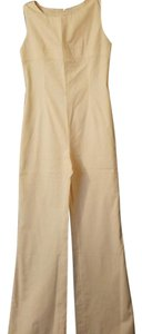 Chanel Peach color jumpsuit with a skirt. 71%cotton 29%silk. Doublure jupe/skirt