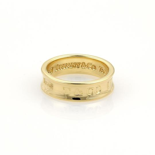 Preload https://img-static.tradesy.com/item/22119403/tiffany-and-co-yellow-gold-1837-collection-6mm-band-size-675-ring-0-0-540-540.jpg