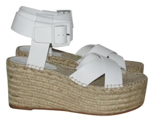 Preload https://img-static.tradesy.com/item/22120415/celine-optic-white-criss-cross-espadrilles-sandals-size-eu-40-approx-us-10-regular-m-b-0-1-540-540.jpg