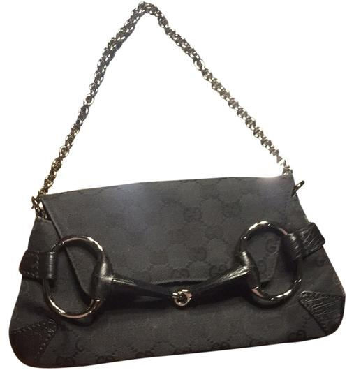 Preload https://item3.tradesy.com/images/gucci-black-canvas-and-leather-clutch-2212052-0-0.jpg?width=440&height=440