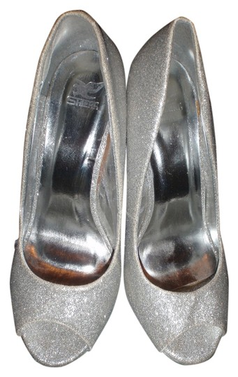 Preload https://item1.tradesy.com/images/shiekh-wedge-size-10-high-heel-silver-sparkles-wedges-2212245-0-0.jpg?width=440&height=440