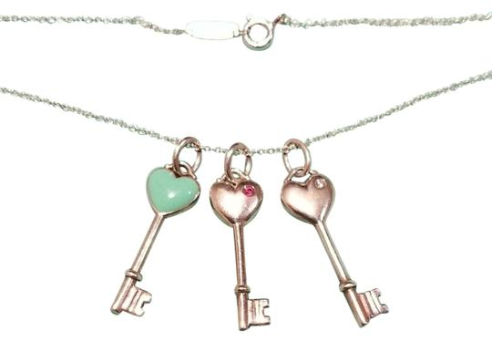 Preload https://img-static.tradesy.com/item/22149136/tiffany-and-co-silver-blue-pink-t-and-co-3-keys-necklace-0-4-540-540.jpg