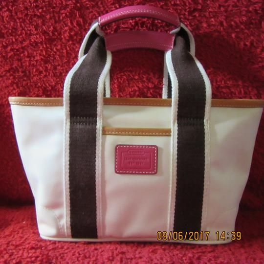 Coach Tote in Beige with pink accents.