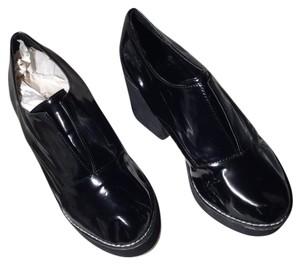 Shellys London Black with white stitching and white rubber sole Boots