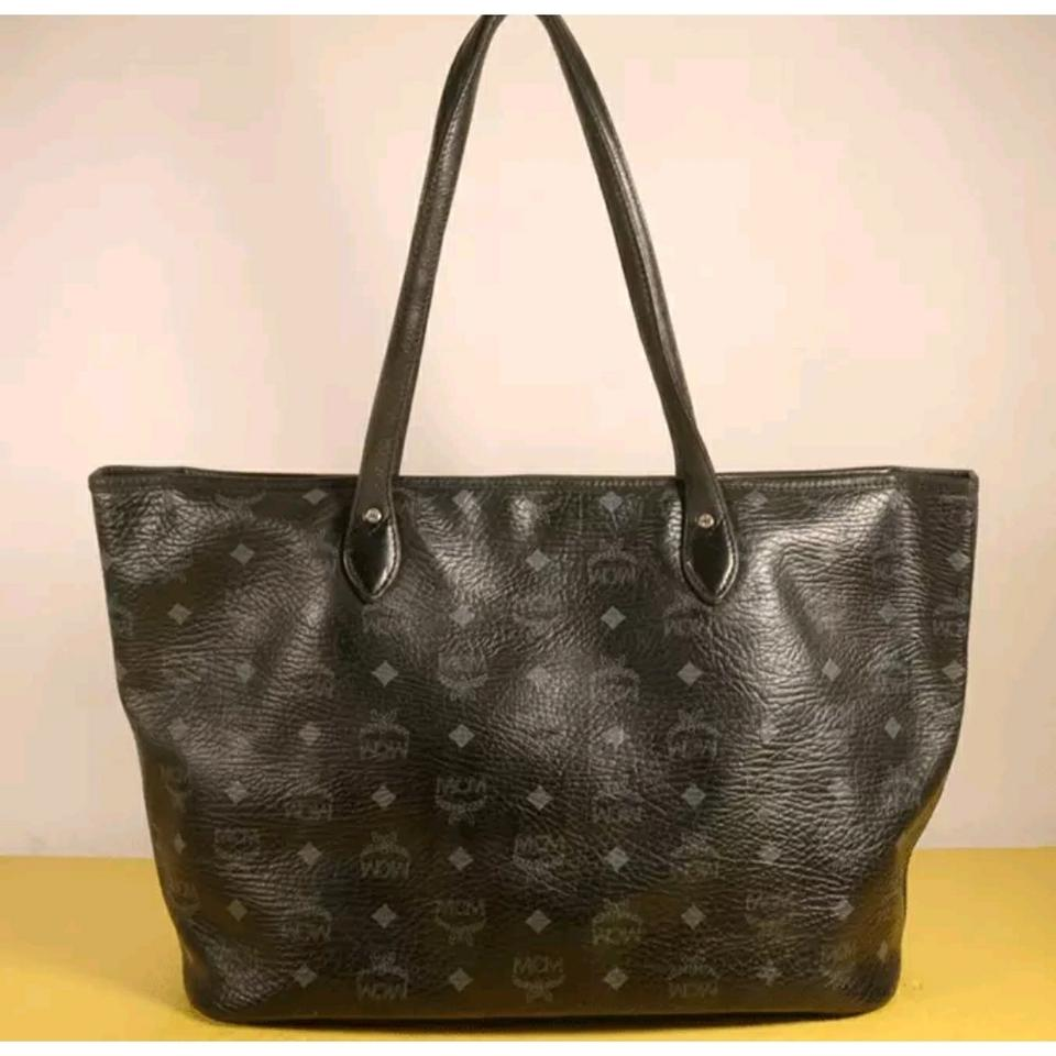 Mcm black leather visetos dog tote tradesy for What does mcm the designer stand for