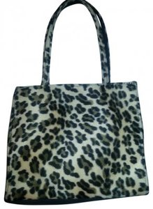 Body Central Animal Print Faux Fur Chic Tote in Black and light brown on beige background