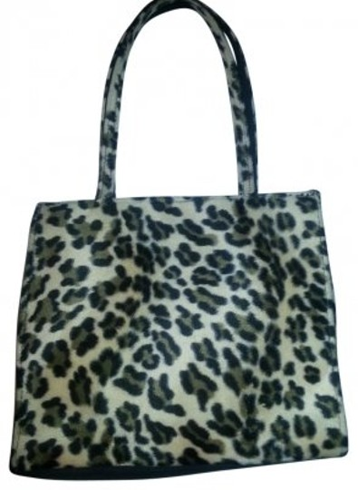 Body Central Tote in Black and light brown on beige background