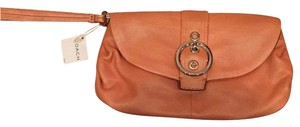Coach Metallic orange Clutch