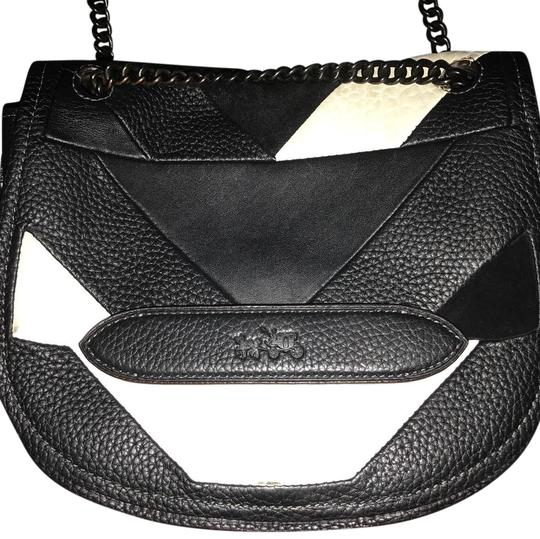 Preload https://img-static.tradesy.com/item/22166483/coach-small-shadow-in-pebble-black-and-white-leather-suede-cross-body-bag-0-1-540-540.jpg