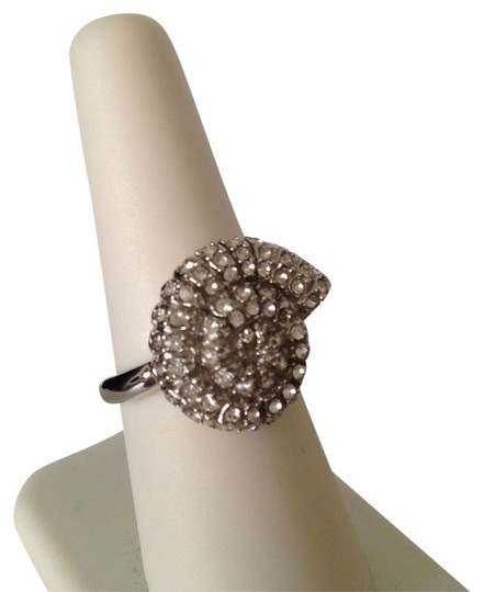 Preload https://item4.tradesy.com/images/silver-nwot-nautilus-shell-white-cubic-zirconia-silver-tone-ring-size-8-2217288-0-0.jpg?width=440&height=440