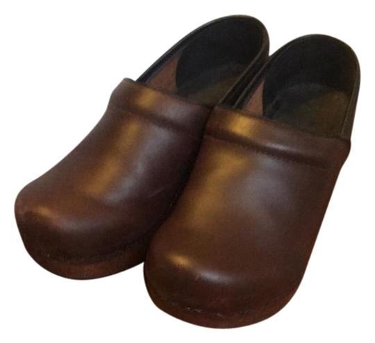 Preload https://img-static.tradesy.com/item/22178009/dansko-brown-leather-with-wooden-frame-worn-twice-some-scuffing-on-front-and-inner-of-mulesslides-si-0-1-540-540.jpg