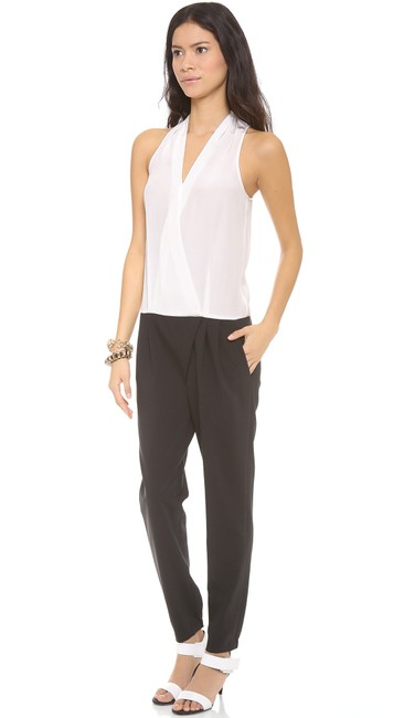 Preload https://img-static.tradesy.com/item/22179776/tibi-black-ivory-tropical-suiting-sleeveless-silk-wool-long-romperjumpsuit-size-2-xs-0-2-650-650.jpg