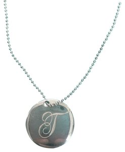 Tiffany co silver initial alphabet t round 075 disc pendant tiffany co silver initial alphabet aloadofball Gallery