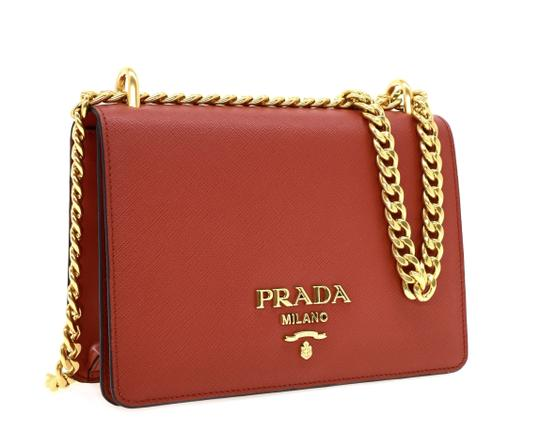Preload https://img-static.tradesy.com/item/22184030/prada-shoulder-chain-red-saffiano-leather-cross-body-bag-0-1-540-540.jpg