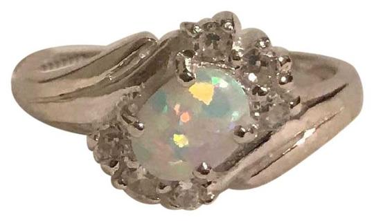 Preload https://item1.tradesy.com/images/white-opal-topaz-accents-ring-22184435-0-3.jpg?width=440&height=440