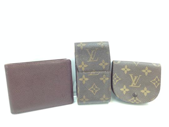 Preload https://img-static.tradesy.com/item/22184484/louis-vuitton-cigarette-case-and-coin-case-3-set-wallet-0-0-540-540.jpg