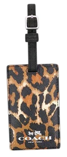 Preload https://item5.tradesy.com/images/coach-natural-multicolor-signature-luggage-tag-f77640-tech-accessory-22185494-0-1.jpg?width=440&height=440