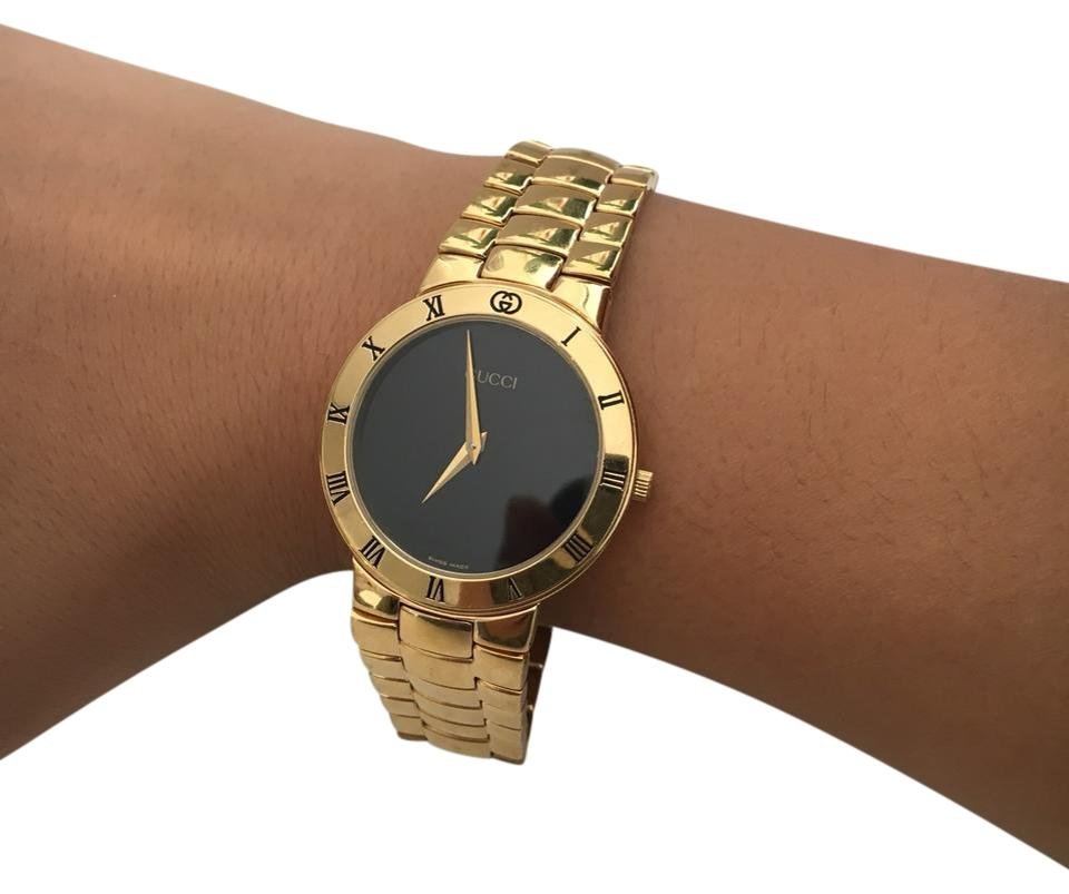 aba1603b653 Gucci Gold Black 3300.2m Watch - Tradesy