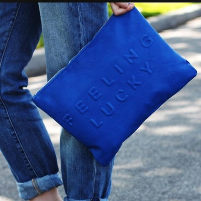 Item - Caution Feeling Lucky Blue Vegan Leather Clutch
