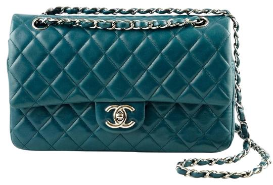 Preload https://img-static.tradesy.com/item/22195252/chanel-classic-flap-quilted-medium-double-blue-lambskin-leather-shoulder-bag-0-3-540-540.jpg